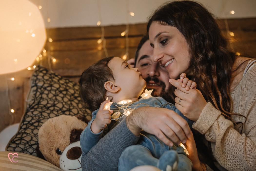 Sessione fotografica di famiglia natalizia, fotografo di famiglia Torino,Natale, luci, candele,bokeh,Natale shabby chic