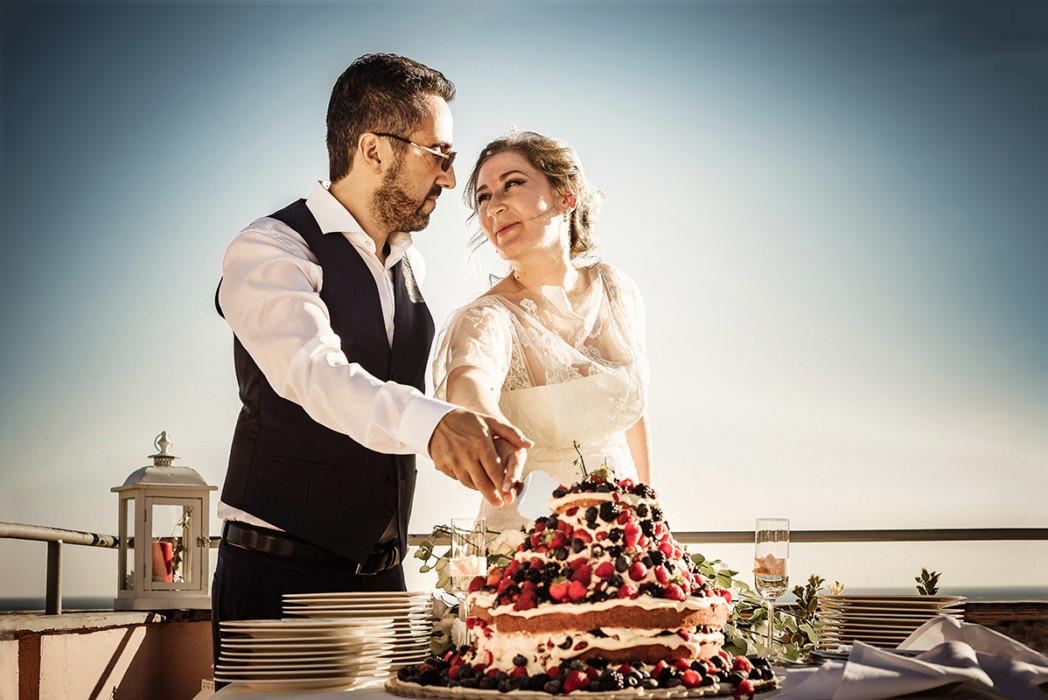 Fotografo matrimonio Torino, matrimonio in Liguria, ad Arenzano, ricevimento al ristorante Punta San Martino,taglio della torta